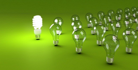 Energy saving and simple light bulbs isolated on green background.
